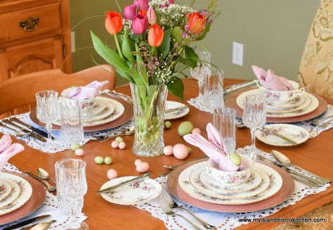 Maple table is set with Royal Albert's Lavender Rose dinnerware. Centerpiece is a large bouquet of pink and orange tulips in tall glass vase