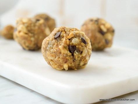 Three Peanut Butter Energy Bites on White Marble Server