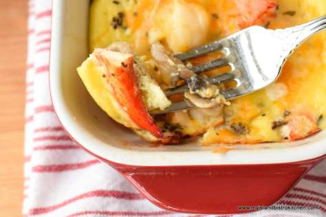 Close-up of a bite of lobster frittata on a fork
