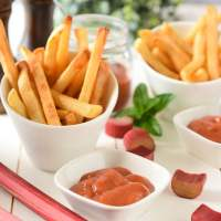 Containers of French Fries and Dishes of Homemade Rhubarb Tomato Ketchup