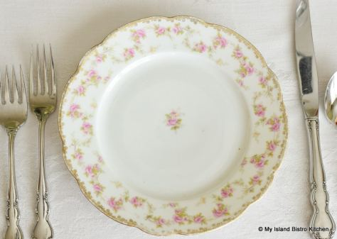 Top-down view of MZ Austria supper plate with pink roses around edge