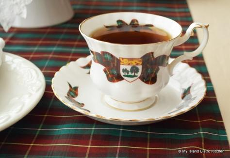 Cup and Saucer with PEI Coat of Arms and PEI Tartan