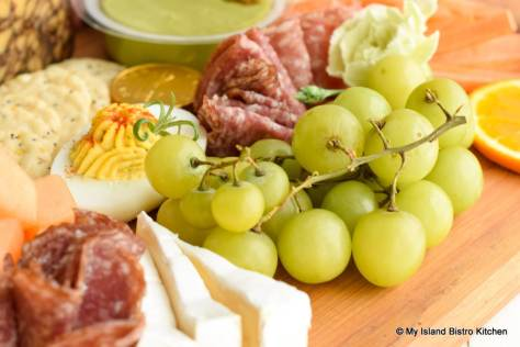 Bunch of Green Grapes on Grazing Board