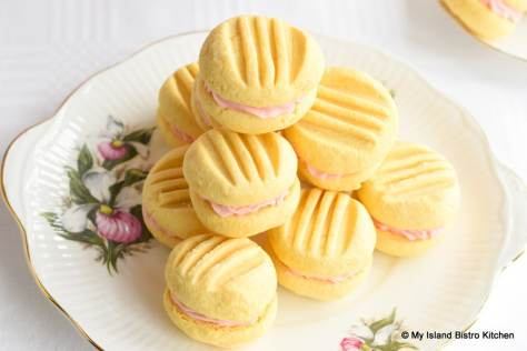 Stack of Custard Sandwich Cookies on Decorative Lady's Slipper Cake Plate