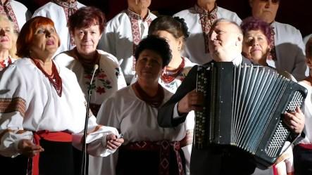 Солистка хора и художественный руководитель, аккомпанемент (баян) хора на юбилейном концерте