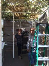 Gail Greenberg and Jeff Lasday lead the sukkah building and decorating at the Jewish Federation.