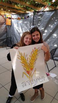 Students at Frankel Jewish Academy decorate their school's sukkah.
