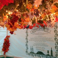 """""""We love Sukkot, I made Star of David garland out of my grandmother's extensive collection of saved cards and tributes from Jewish holidays from decades past. It feels like having her near when I'm in there."""" — The Bass Family of West Bloomfield"""