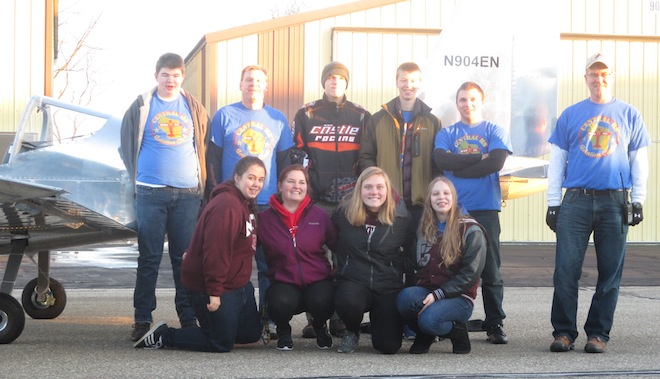 Members of Westosha Central's STEM Aviation Club come together with Falcon 1, an airplane they completed after 13 months of work. Among the 15 students who worked on the plane are (front row, from left) seniors Olivia Rasmussen, Angel Heathcoe, Nicole Jackson and sophomore Rachel Senft; (back row) sophomore Alex McGonegal, program mentor James Senft, senior Jake Lampada, sophomore Josh Engeberg, home-schooled student Declan Steinke and volunteer Ron Chisholm.