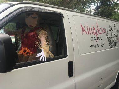 Scarecrow Driving a Van