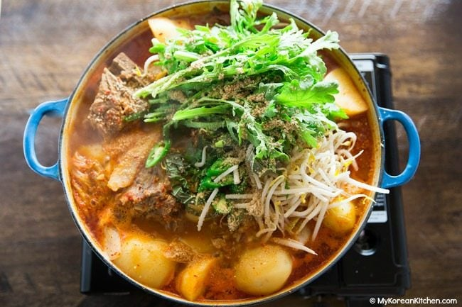 Boiling Gamjatang (Korean Pork Bone Soup) on gas bunner