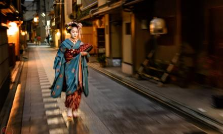 Maiko Fumiyoshi walking through the night