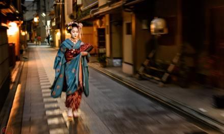 Maiko Fumiyoshi walking through the night