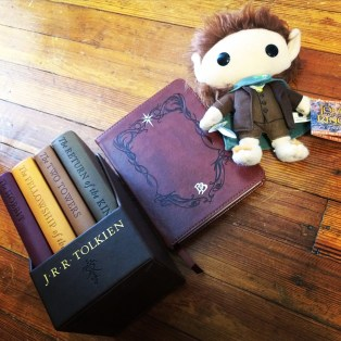 I would of course take a nice pretty and small set of The Hobbit/LOTR (it counts as one!!), a journal to write down all of my adventures and my Frodo plush because it's adorable. Btw I'm completely obsessed with that journal, makes me feel like Bilbo.