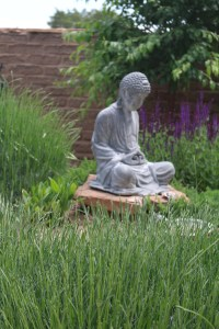 It's only fitting to end the garden tour with this Buddha sculpture in the garden. Namaste.