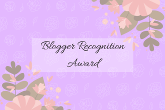 Blogger REcognition Award title picture, on a purple background with digitally drawn flowers in the top right corner and bottom left corner.