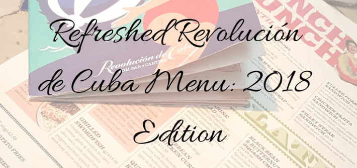 "A photo of the drinks menu placed atop the food menu at Revolución de Cuba on top of a white checked table, with blue squares. The the title words ""Refreshed Revolución de Cuba Menu, 2018 Edition written across the top of it."