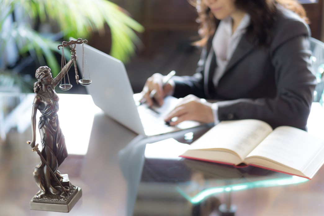 female attorney working at a desk