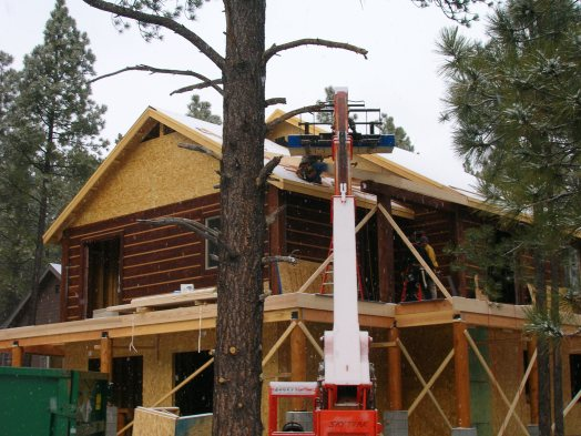 Myles Nelson McKenzie Design-Custom Square Log Mountain Home-Roof Sheeting in the Snow