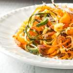 Extreme closeup of roasted veggie noodles.