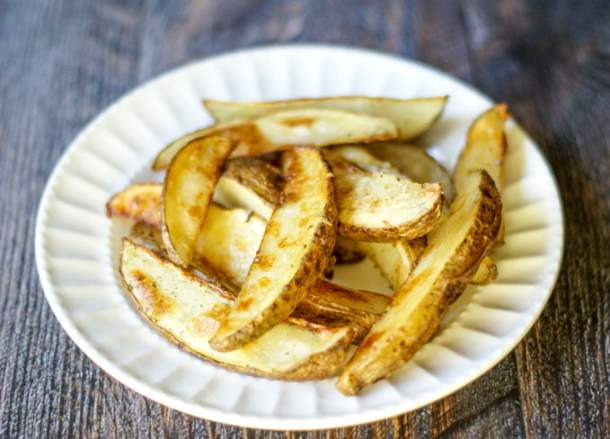 white plate with crispy oven baked fries