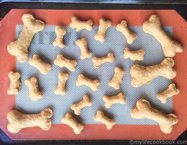 cooked dog biscuits on silicone mate in shape of dog bone