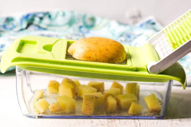 vegetable chopper with a raw potato