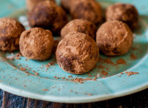 closeup of low carb protein balls covered in cocoa powder