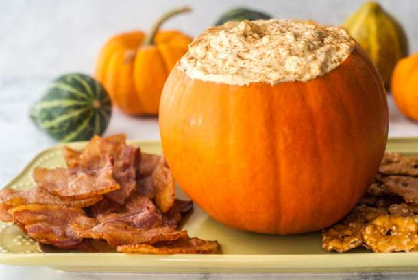 This pumpkin cheesecake dip with bacon chips is the perfect combination of salty and sweet and just happens to be low carb too! This is an appetizer everyone will love because, hey... it's bacon and cheesecake!