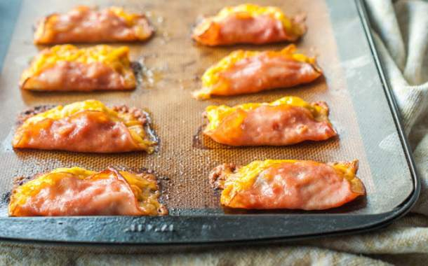 These low carb breakfast ham tacos are an easy to make grab and go breakfast. Make a batch and freeze for later. Only  0.7g per serving.