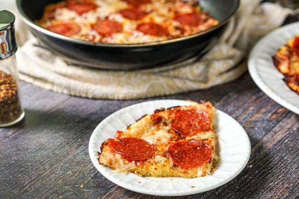 If you ever had spaghetti pizza, you will love this low carb version. Skillet spaghetti squash pizza is a low carb and gluten free answer to your pasta and pizza cravings. The recipe makes 8 big servings as only 4.4g net carbs!