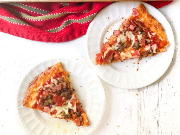pieces of meat lover's low carb pizza on white plates