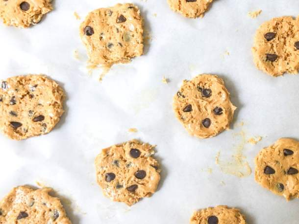 raw peanut butter cookie dough cookies on a parchment paper tray