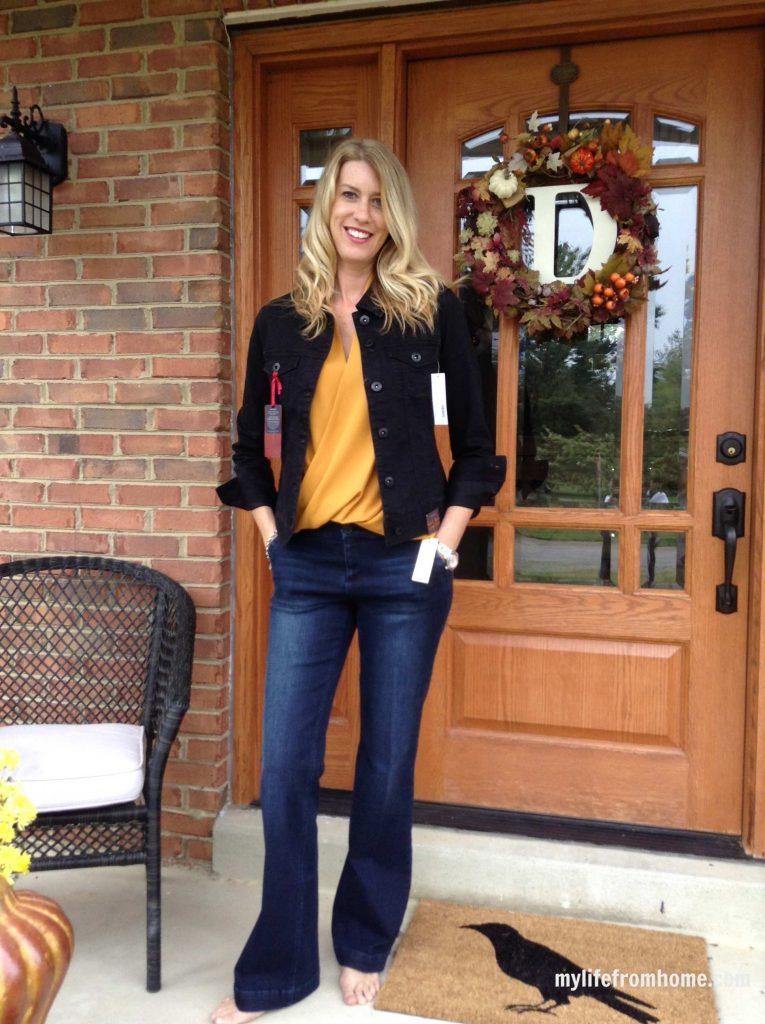 Mustard twist front sleeveless blouse, black denim jacket, trouser jeans