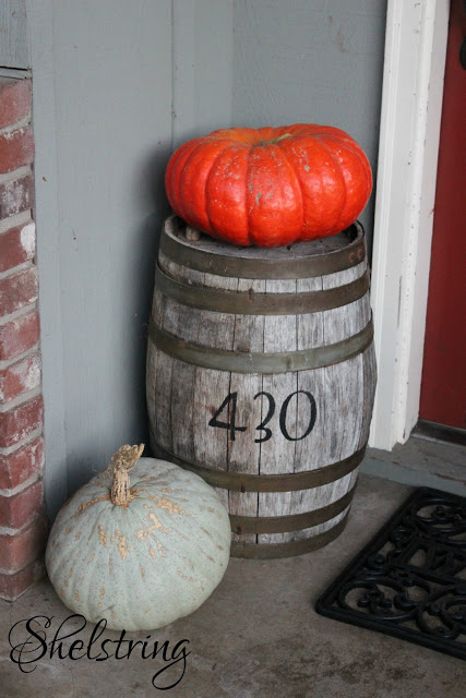 Pumpkins and barrel