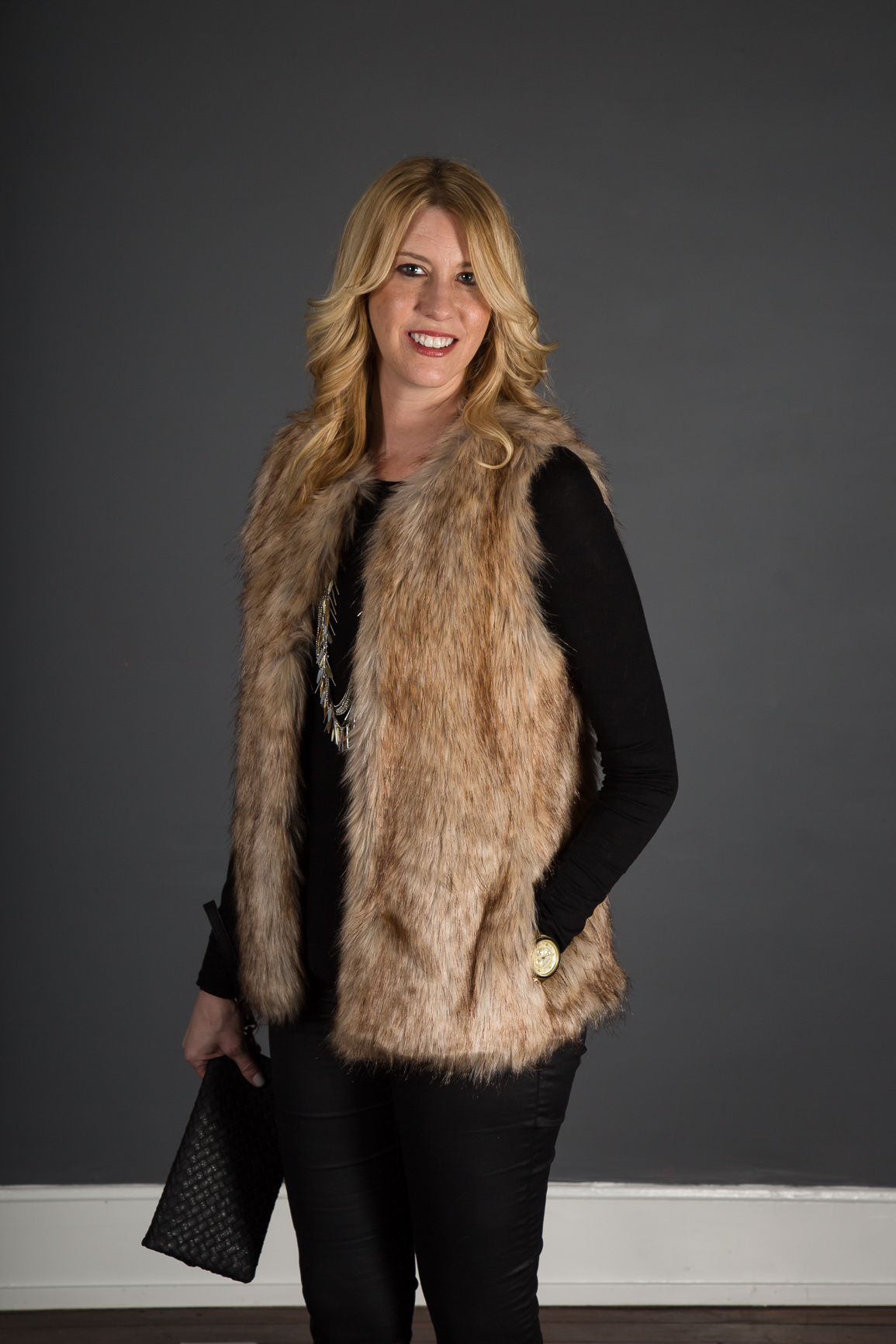 fur vest & coated denim outfit