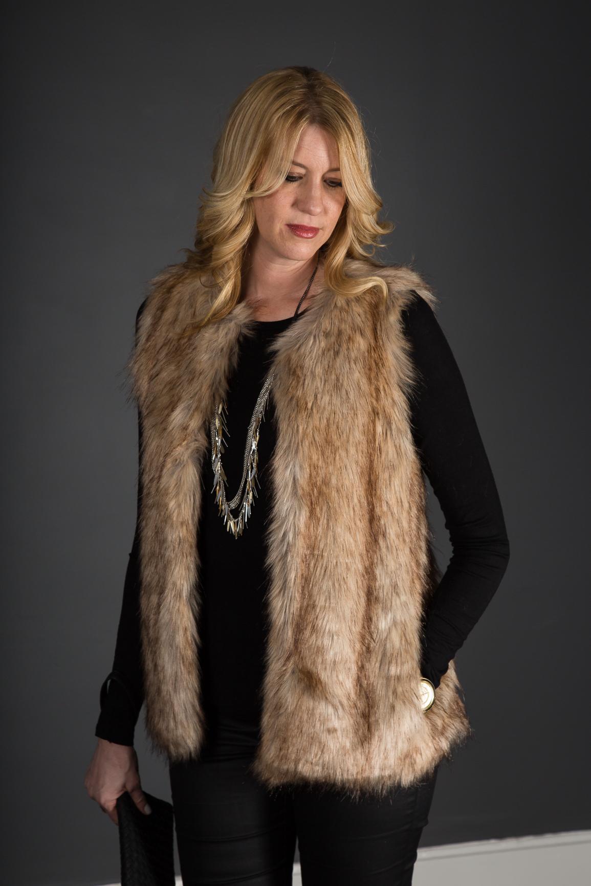 fur vest & coated denim outfit