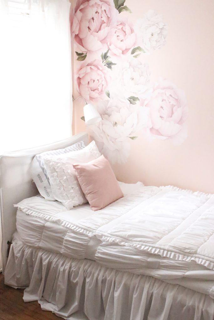 Sweet & Feminine Tween Girl bedroom space- kids bedrooms- girl bedrooms- flower wall decals- white ruffled bedding- pink room- home design- home decor- wall decor ideas- bedroom decor ideas- white bedding- peony wall paper- flower wallpaper decals- blush walls- Beddy's bedding- zip up bedding- pink and gray- removable wall decals- teen bedroom- home decor- DIY