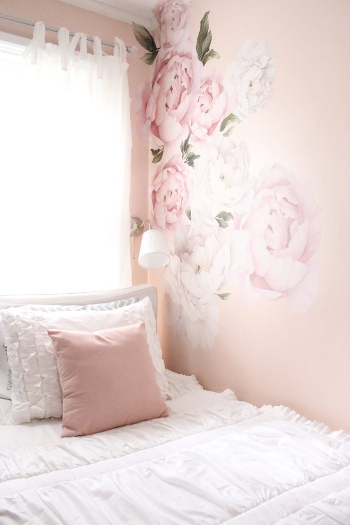 Sweet & Feminine Tween Girl bedroom space- kids bedrooms- girl bedrooms- flower wall decals- white ruffled bedding- pink room- home design- home decor- wall decor ideas- bedroom decor ideas- white bedding- peony wall paper- flower wallpaper decals- blush walls