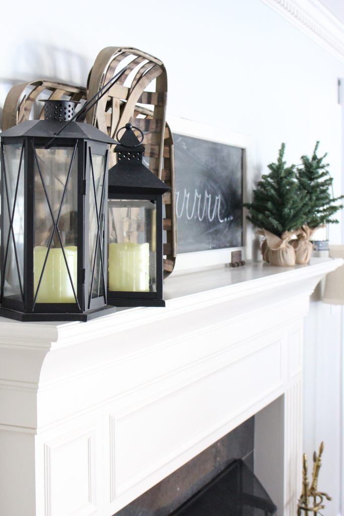 Cozy Peaceful Winter Mantel- mantel decor- room design- rustic home decor- wall decorating ideas- mantle- decoration ideas- living room decorating ideas- DIY- DIY projects- home decor- winter decor- winter decorating- winter mantel- lanterns- tobacco baskets
