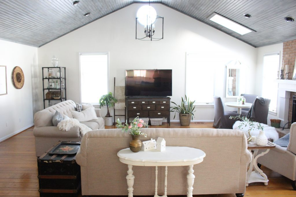 Gray and White Cottage Living Space- farmhouse style room- decor- DIY- weathered wood ceiling treatment- painted ceiling- paint and stain treatment on pine- how to- paint- stain- wood- ceiling- winter decor- room design- home decor- living room decorating ideas- rustic home decor- wall decorating ideas- decoration ideas- room decor ideas- mantel ideas- french county style decor-tv room- vaulted ceilings