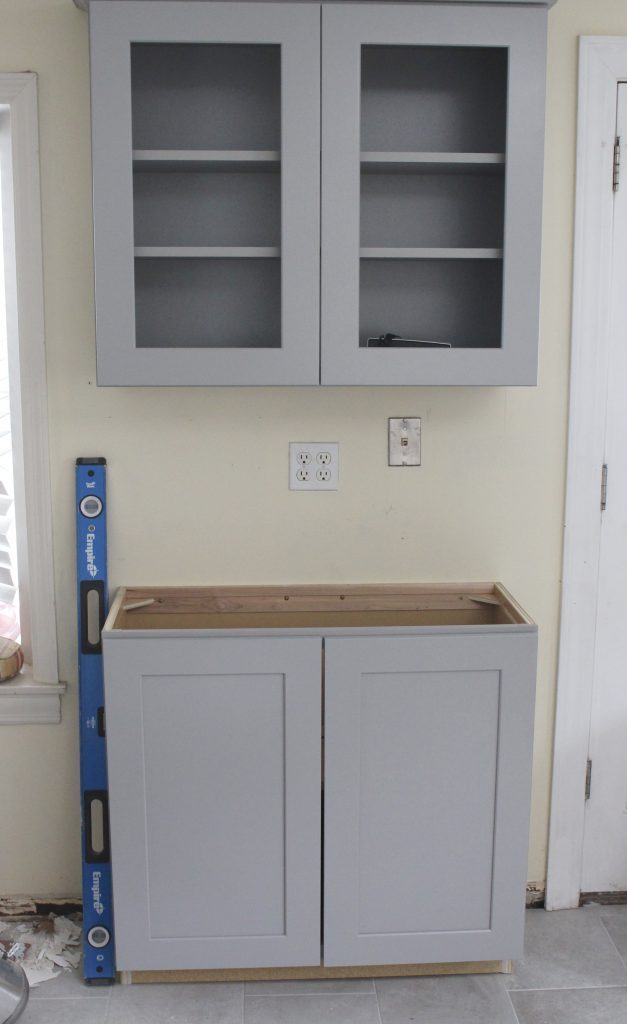 Warm and Inviting White Cottage Kitchen Renovation Update- Halfway mark of the kitchen reno- white and gray kitchen cabinets- home design- farmhouse sink- hutch- Woodmark- Home Depot cabinets- DIY- DIY projects- renovations- home design ideas- built in hutch