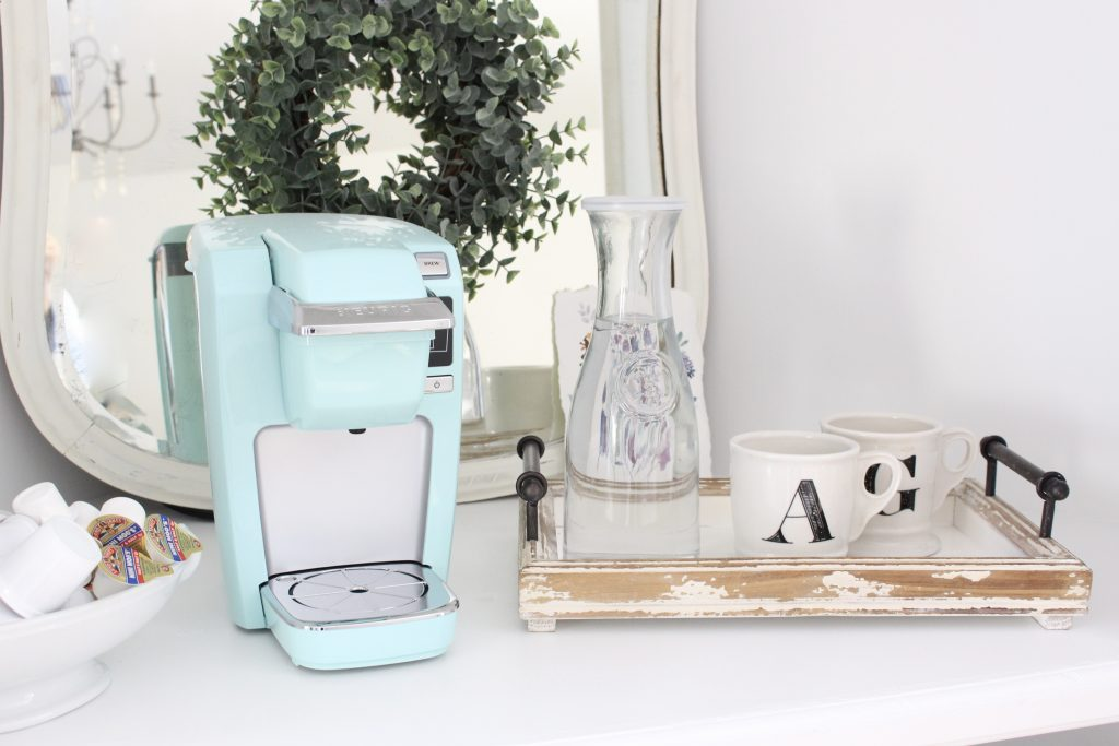 White Cottage Style Bedroom with bookcases- shabby chic style- cottage style- coffee station- bedroom design- how to style a coffee station- bookcase- DIY- DIY projects- Keurig- mint green coffee maker- white bedroom decor- room design- styling a bookcase- coffee tray