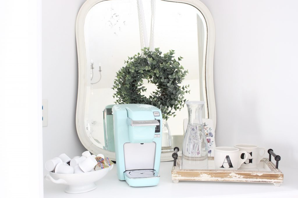 White Cottage Style Bedroom with bookcases- shabby chic style- cottage style- coffee station- bedroom design- how to style a coffee station- bookcase- DIY- DIY projects- Keurig- mint green coffee maker- white bedroom decor- room design- styling a bookcase- coffee tray- white mirror