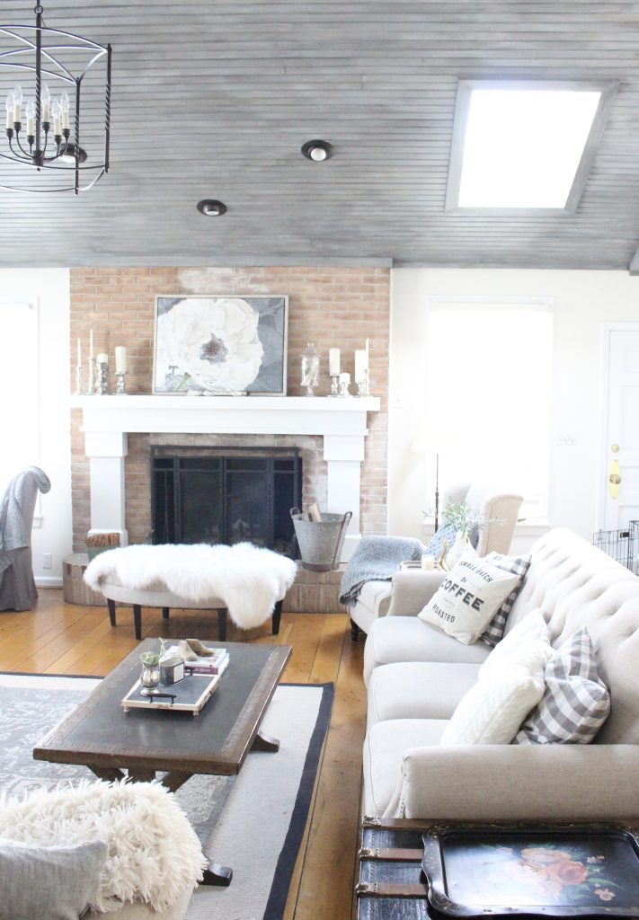 Gray and White Cottage Living Space- farmhouse style room- decor- DIY- weathered wood ceiling treatment- painted ceiling- paint and stain treatment on pine- how to- paint- stain- wood- ceiling- winter decor- room design- home decor- living room decorating ideas- rustic home decor- wall decorating ideas- decoration ideas- room decor ideas- mantel ideas- french county style decor-tv room- coffee table decor
