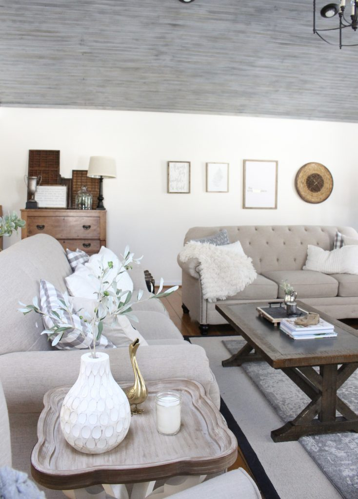 Gray and White Cottage Living Space- farmhouse style room- decor- DIY- weathered wood ceiling treatment- painted ceiling- paint and stain treatment on pine- how to- paint- stain- wood- ceiling- winter decor- room design- home decor- living room decorating ideas- rustic home decor- wall decorating ideas- decoration ideas- room decor ideas- mantel ideas- french county style decor-tv room- soft pastel colors