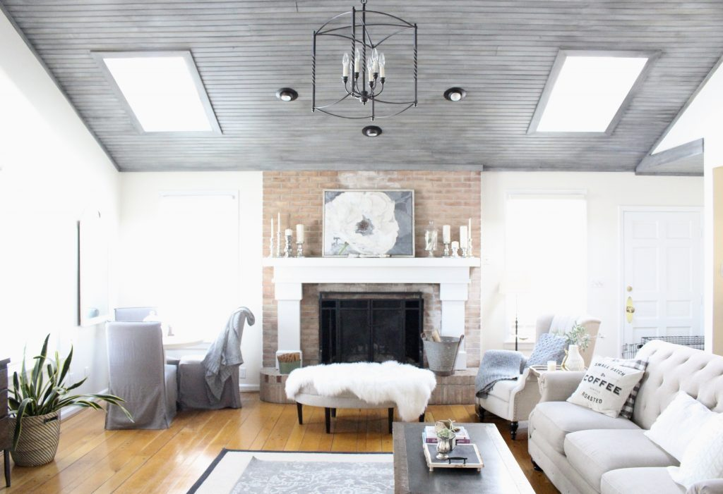 Gray and White Cottage Living Space- farmhouse style room- decor- DIY- weathered wood ceiling treatment- painted ceiling- paint and stain treatment on pine- how to- paint- stain- wood- ceiling- winter decor- room design- home decor- living room decorating ideas- rustic home decor- wall decorating ideas- decoration ideas- room decor ideas- mantel ideas- french county style decor-tv room- cottage style home