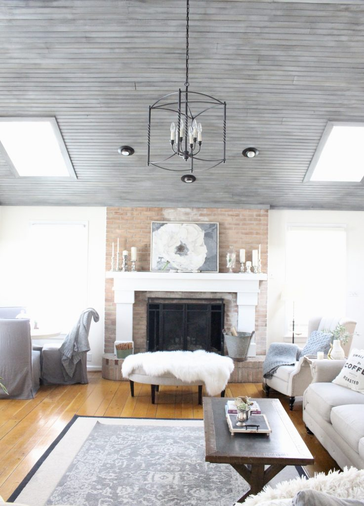 Gray and White Cottage Living Space- farmhouse style room- decor- DIY- weathered wood ceiling treatment- painted ceiling- paint and stain treatment on pine- how to- paint- stain- wood- ceiling- winter decor- room design- home decor- living room decorating ideas- rustic home decor- wall decorating ideas- decoration ideas- room decor ideas- mantel ideas- french county style decor-tv room- lantern chandelier