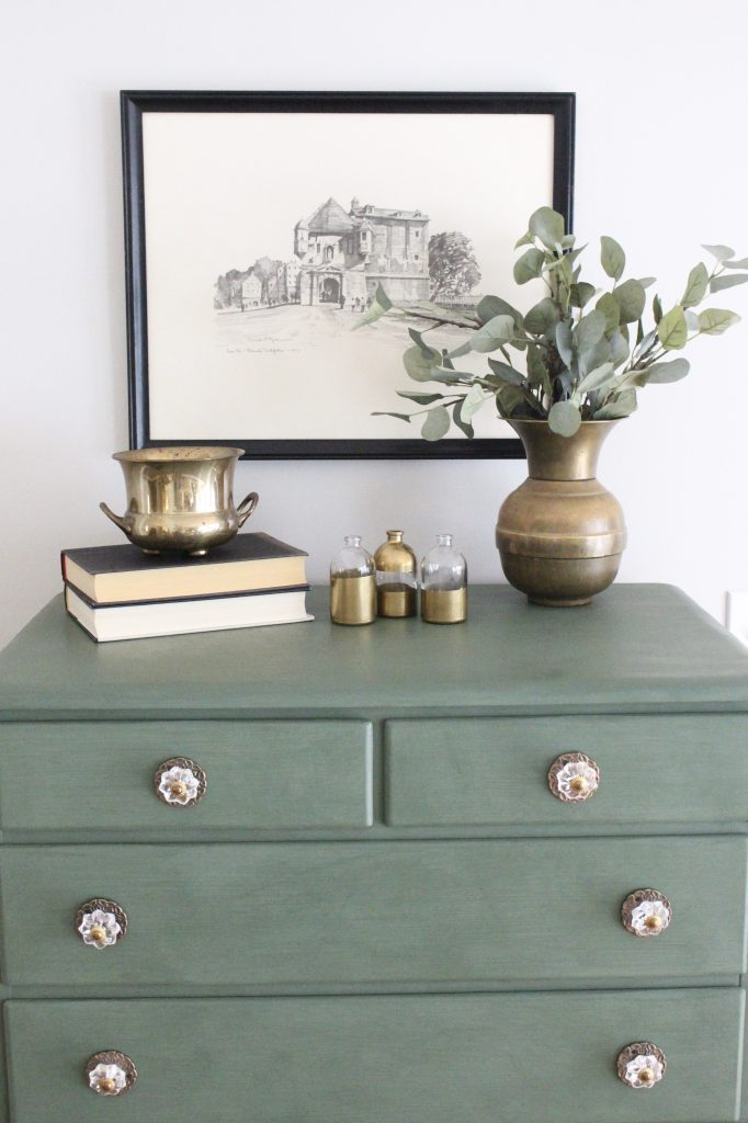 A wood dresser painted green- Amy Howard paints- One step paint- green- Cherbourg- how to use chalk paint- chalk painted finish- green furniture- how to paint furniture- home design- DIY- Do it Yourself project- painted furniture- gold and crystal knobs