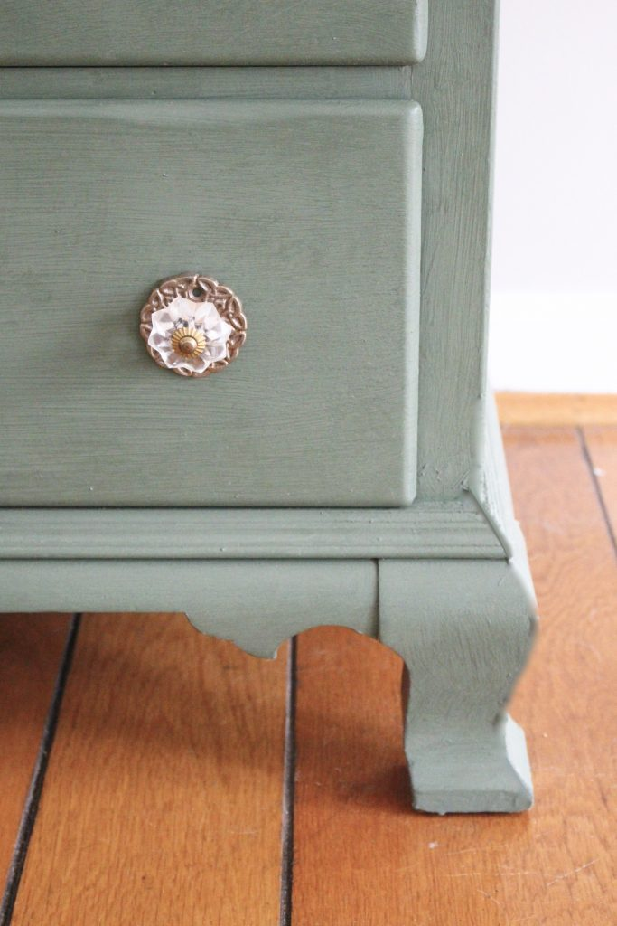 A wood dresser painted green- Amy Howard paints- One step paint- green- Cherbourg- how to use chalk paint- chalk painted finish- green furniture- how to paint furniture- home design- DIY- Do it Yourself project- painted furniture- living room decorating ideas